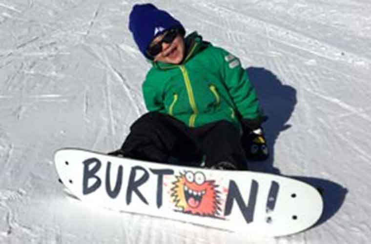 kids snowboard lesson in tignes image of
